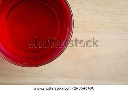 top view red sweet drink on the block - stock photo