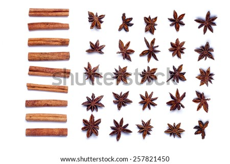 Top view row of aromatic cinnamon sticks and star anise. - stock photo