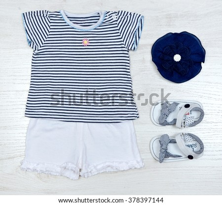 top view set of fashion trendy clothes for little  baby, fashion concept, marine style - stock photo
