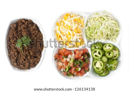 Top view shot taco ingredients isolated over a white background - stock photo