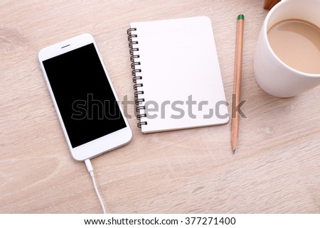 top view smartphone mockup with coffee and note paper on wooden background - stock photo