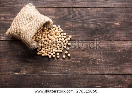 Top view soybean on wooden background and empty space - stock photo