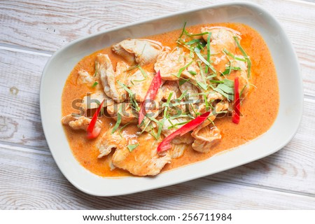Top view, Spicy Thai Food Red Curry Chicken on wood - stock photo