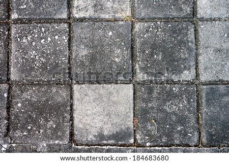 Top view Square brick on pavement - stock photo