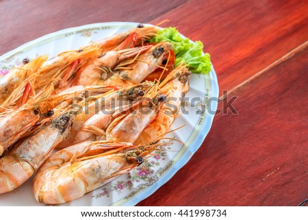 Top view steamed shrimp/prawn in the white plate ready to eat - stock photo