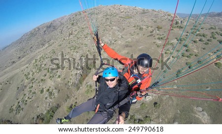 Top view tandem tourist paragliding - stock photo