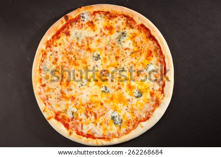 Top view tasty italian pizza on dark background  - stock photo