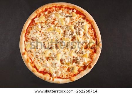 Top view tasty italian pizza on dark background  - stock photo