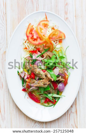 Top view - Thai style roast beef with salad and Chili Sauce