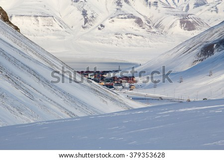 Top view. The city is surrounded by mountains. Longyearbyen, Spitsbergen (Svalbard). Norway - stock photo