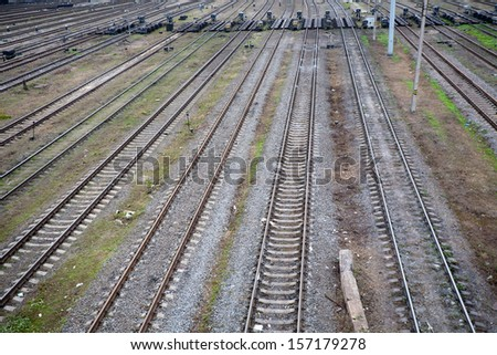 top view to a lot of parallel railway lines - stock photo