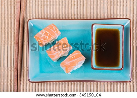 Top view to california maki sushi with fish. Roll made of salmon, cream cheese and  cucumber.  - stock photo