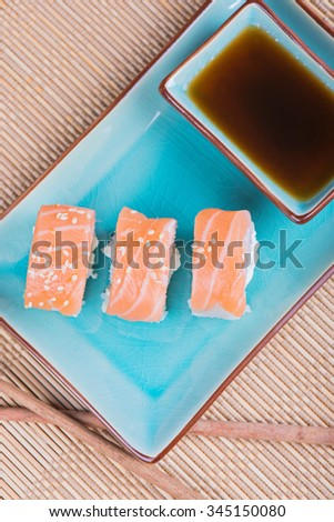 Top view to california maki sushi with salmon. Roll made of salmon, cream cheese and  cucumber.  - stock photo