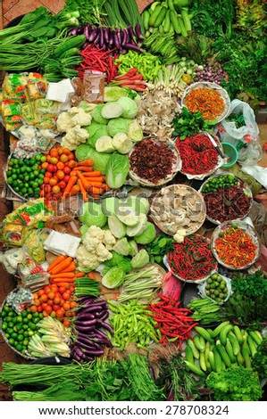 Top view various raw colorful vegetables tropical variety