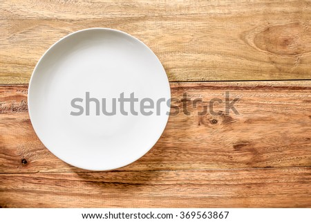 Top view white Empty plate on old wooden background.