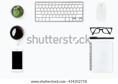 Top view with copy space of white working desk table with computer gadgets, smartphone, office supplies and coffee. Flat lay. - stock photo