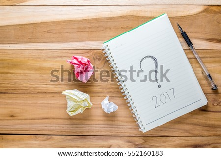 Top view 2017 with notebook on wooden desk