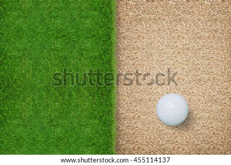 Top views of golf ball with green grass texture and sand background.