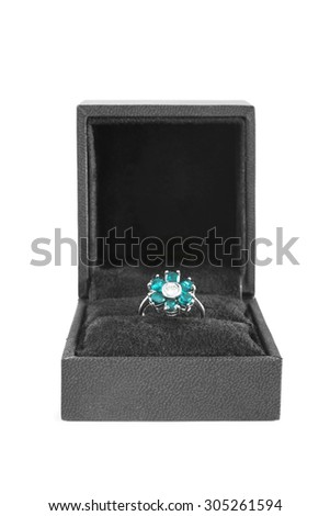 Topaz ring in the shape of a flower in jewel box - stock photo