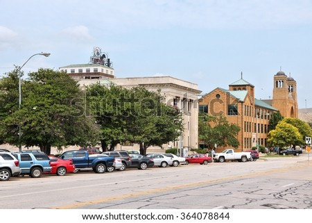 TOPEKA, USA - JUNE 25, 2013: People visit downtown Topeka, Kansas, United States. Topeka is the capital city of the State of Kansas and is the 4th biggest populated area in Kansas.