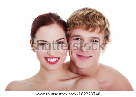 Topless couple standing against white background.