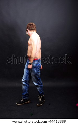 topless man wears jeans