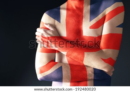 Topless man with Great Britain Flag painted on his body. Patriotism and national team support concept. - stock photo