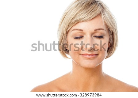 Topless unclad woman, eyes closed. - stock photo