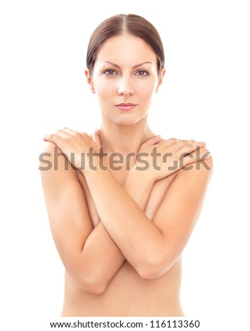 Topless woman body covering her breast with hand, isolated on white