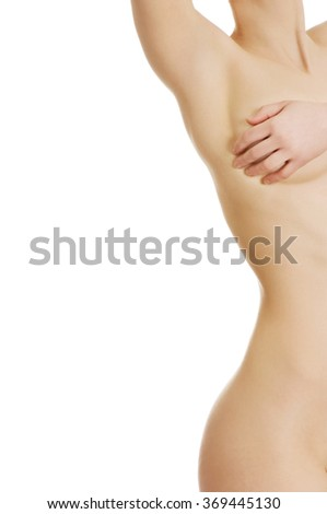 Topless woman covers her breast. - stock photo