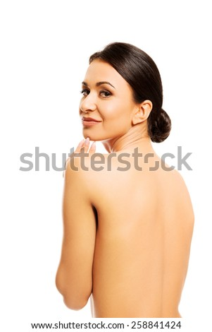 Topless woman touching her chin.