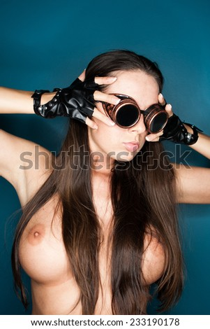 topless woman with steampunk glasses posing - stock photo