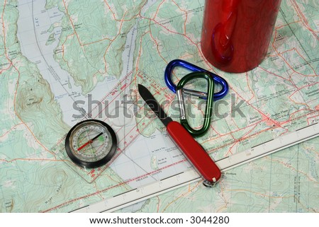 Topographic map with accessories for hiking
