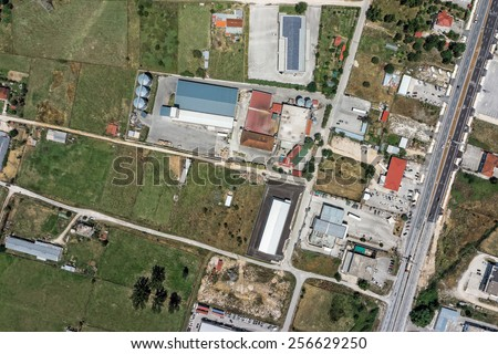 Topographical vertical aerial view of industrial area, soft focus - stock photo