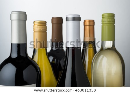 Tops of wine bottles showing different varietals