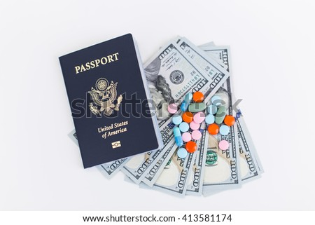 Topview of american passport, dollars and pills on white surface. Concept of going abroad for medical treatment - stock photo