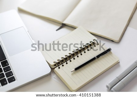 Topview of blank notepads, keyboard, pen and markers - stock photo