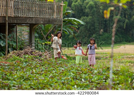Toradja, Sulawesi, Indonesia - AUG 26, 2014: The village children waving happily in greeting