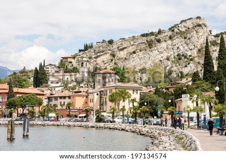 TORBOLE, ITALY - APRIL 22: The village of Torbole. Italy on April 22, 2014. The town is located at Lake Garda, the biggest lake of Italy, which is popular for windsurfing.