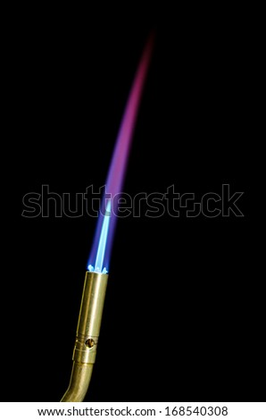 Torch tip & flame isolated in black
