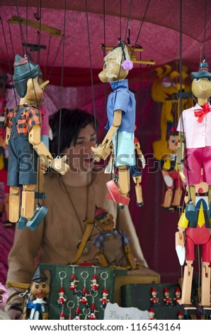 TORDESILLAS (VALLADOLID, SPAIN - OCTOBER 7: An unidentified woman in her stall puppet on the medieval market celebrated every year, on October 7, 2012 in Tordesillas (Valladolid), Spain - stock photo
