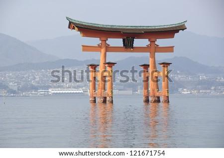 Tori gate at Itsukushima Shrine on Miyajima Island, near Hiroshima, Japan - stock photo