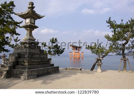 Tori gate of the Itsukushima Shrine on Miyajima Island, near Hiroshima, Japan - stock photo