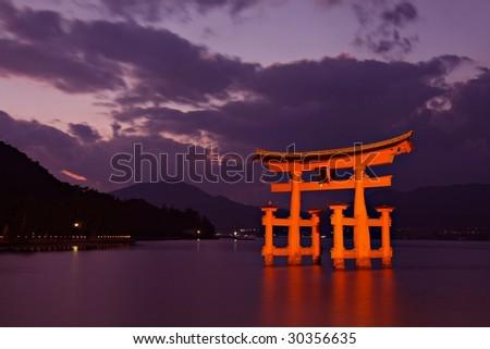 Torii gate at Miyajima, near Hiroshima - Japan - stock photo