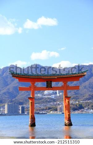 Torii Gate of Miyajima, Japan with blue sky - stock photo
