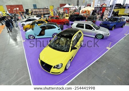TORINO, ITALY - FEBRUARY 15, 2015: A Exposition of different tuned cars on display at Expo Tuning Torino. Special edition of personalized Volkswagen Golf in Torino business place on February 15, 2015 - stock photo