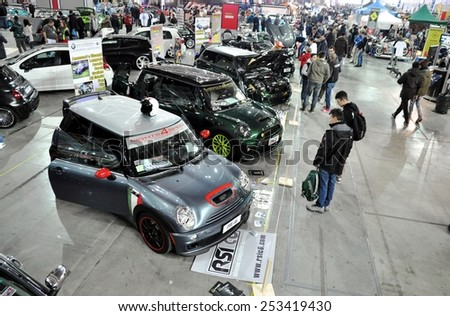 TORINO, ITALY - FEBRUARY 15, 2015: Colored Mini Cooper tuning cars exposed at Expo Tuning Torino which is a tuning motor show that takes place every year on Torino business place on February 15, 2015 - stock photo