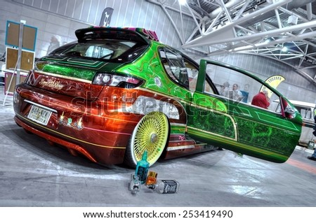 TORINO, ITALY - FEBRUARY 15, 2015: colored tuned car exposed at  Expo Tuning Torino with Suicide Door, is the slang term for a door hinged at its rear rather than the front, on February 15, 2015 - stock photo