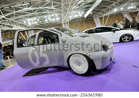 TORINO, ITALY - FEBRUARY 15, 2015: Special edition of tuned and lowered Renault Twingo with very big wheels on display at Expo Tuning Torino business place on February 15, 2015 - stock photo