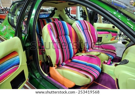 TORINO, ITALY - FEBRUARY 15, 2015: Vintage and colored tuned car  interior at Expo Tuning Torino with Suicide Door, is the door hinged at its rear rather than the front, on February 15, 2015 - stock photo